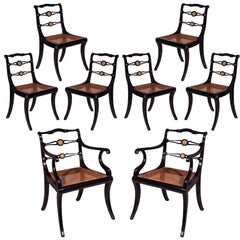 Set of Eight Regency Black Lacquer Gilt-Brass Mounted Klismos Dining Chairs