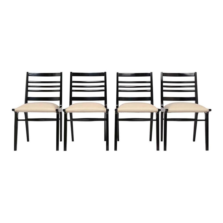 An extraordinary set of 8 Modern-style Dining Chairs crafted from maple wood has been professionally restored. This Daning chairs feature sleek design frame laddered backrests resting on stretched taper legs and has a newly ebonized lacquered