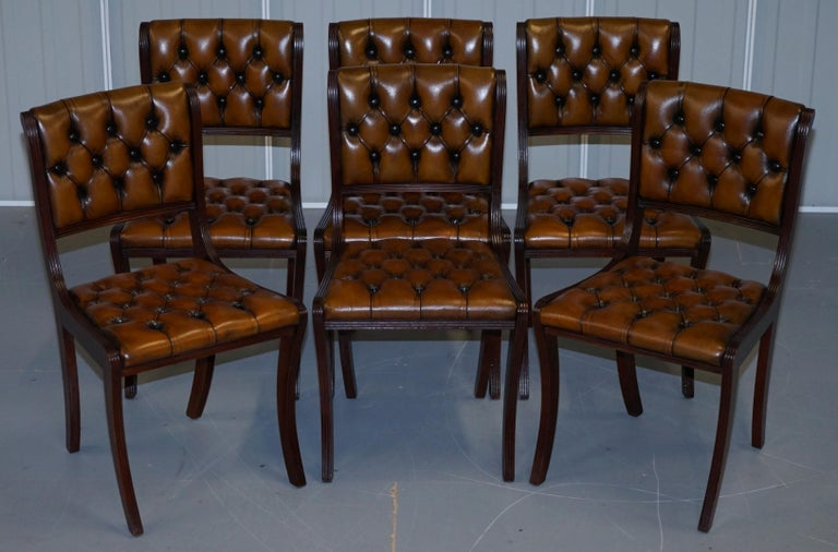 We are delighted to offer for sale this stunning set of eight Vintage fully restored Chesterfield aged cigar brown leather dining chairs  A very good looking and well made suite, the frames are all mahogany, they have reeded frames running down