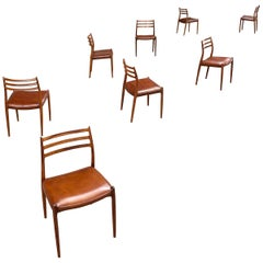 Set of Eight Rosewood Dining Chairs Designed by Niels O. Moller for J.L. Moller