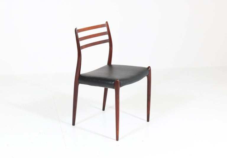 Faux Leather Set of Eight Rosewood Model 78 Chairs by Niels O. Møller for J.L. Møllers, 1954 For Sale
