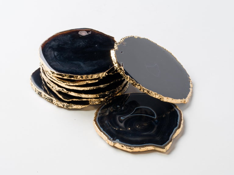 Stunning natural agate and crystal coasters with 24 karat gold plated edges. Polished fronts and natural rough edges. No two pieces are alike. Make beautiful accessories to any coffee table or dining table setting. Three color variations are