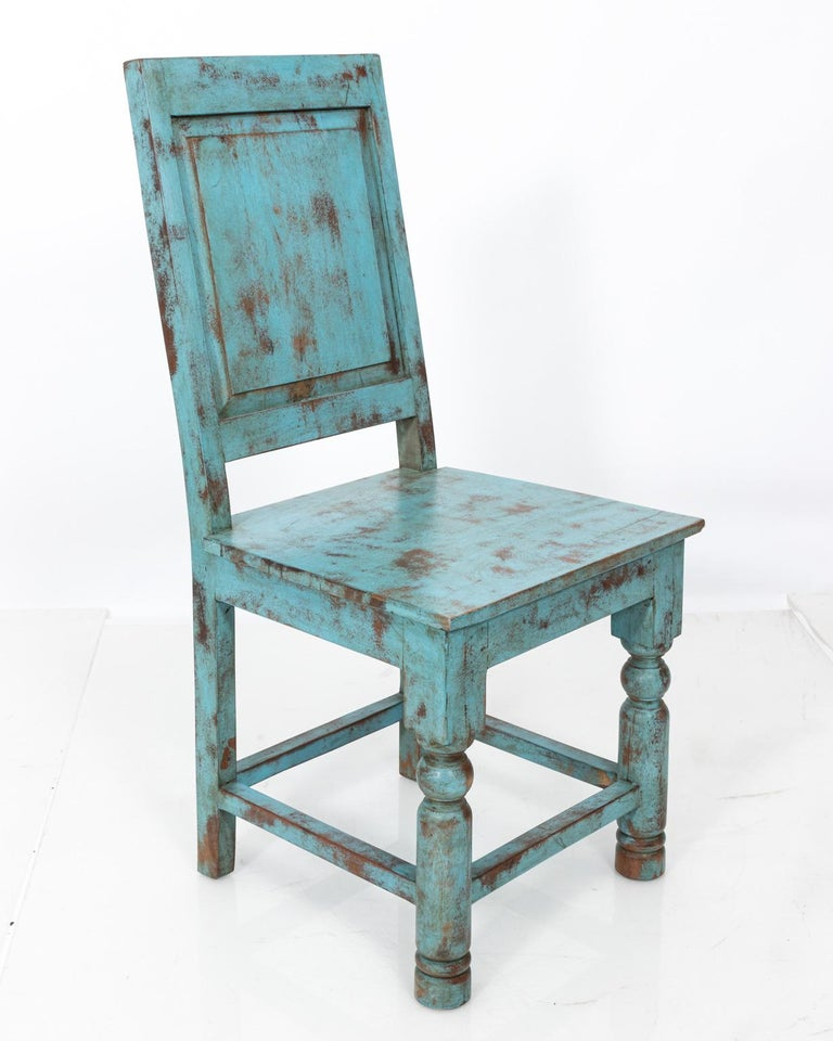 Set of eight Swedish style blue painted chairs with square backs. Please note of wear due to age and daily use including cracks on the seats and backs.