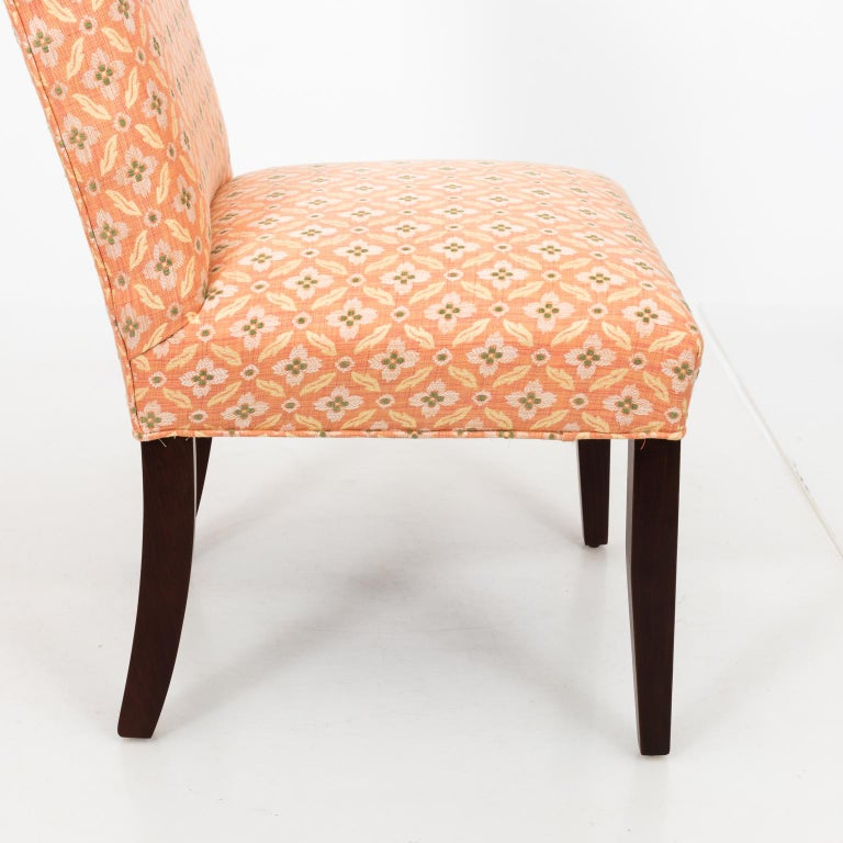 Set of eight upholstered custom dining chairs in Brunschwig & Fils fabric.