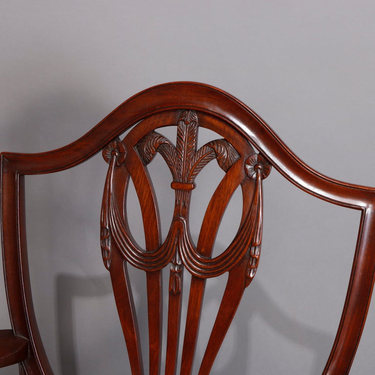 Carved Set of Eight Vintage English Mahogany Shield Back Dining Chairs, circa 1930 For Sale