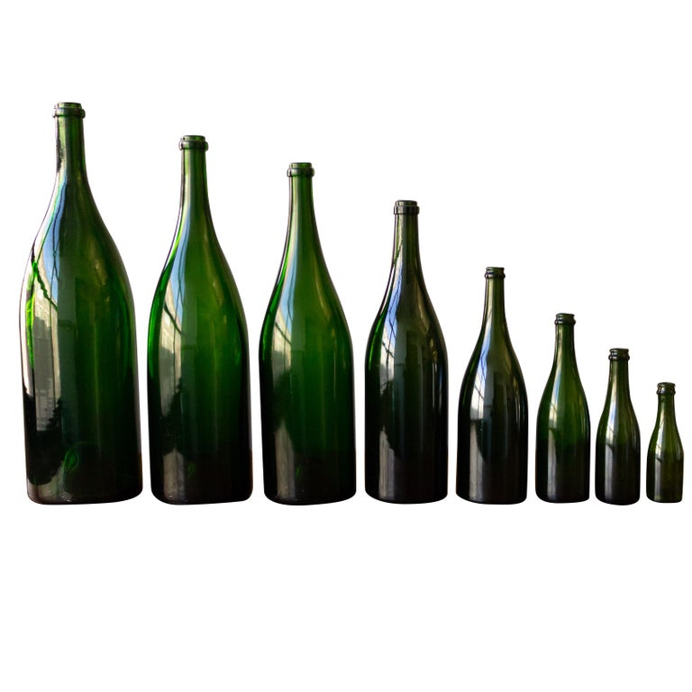 Set of Eight Vintage French Champagne Bottles For Sale