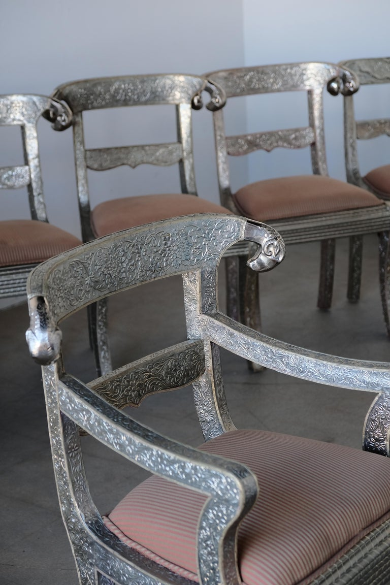 Set of Eight Vintage Rams Head Anglo-Indian Embossed Silver Metal Dining Chairs In Good Condition For Sale In Palm Springs, CA