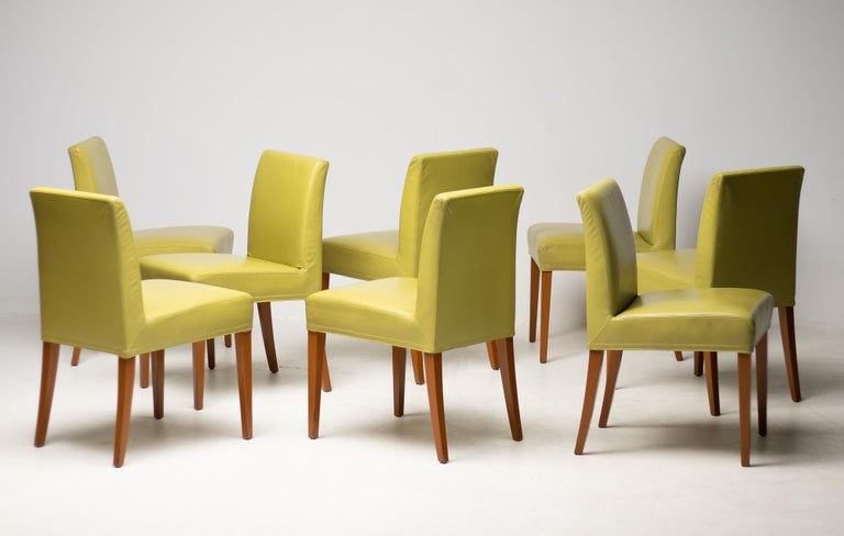 Elegant set of 8 Wittmann avocado green dining room chairs. A timeless Classic due to its clear, straightforward lines, this chair is suitable for a wide variety of domestic and architectural uses.  The sprung backrest and pocket-sprung seat make