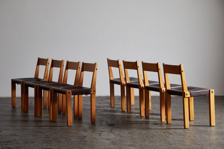 Set of eight S24 patinated leather and elm dining chairs by Pierre Chapo. Made in France, circa 1967.