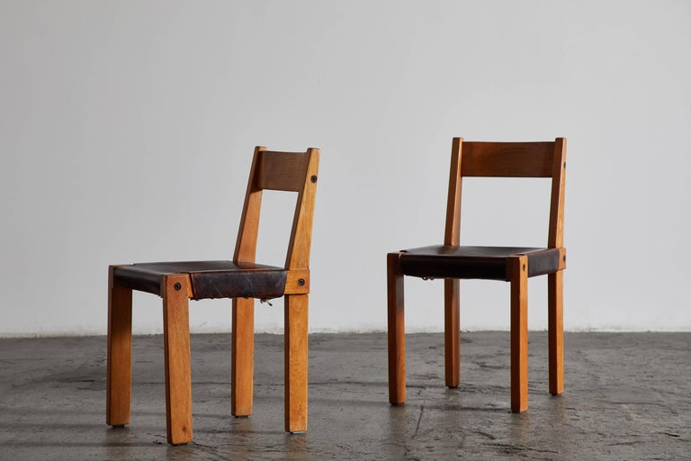 Mid-20th Century Set of Eight Wood and Leather Dining Chairs by Pierre Chapo For Sale