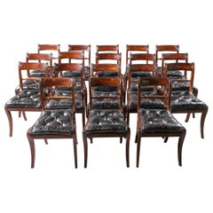 Set of Eighteen Brown and Black Regency Dining Chairs