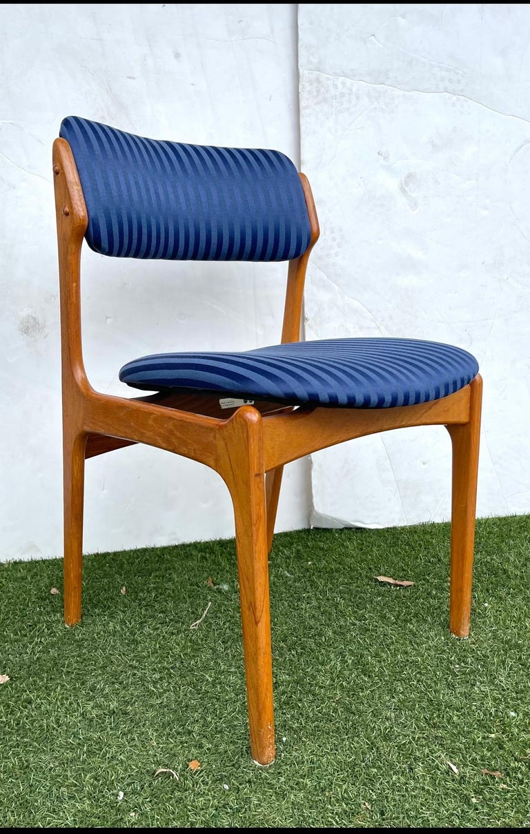 """A set of 4 teak chairs by Erik Buch for O.D. Mobler A-S The chairs have a wonderful sculptural feel to them.  Design is enhanced by an almost floating appearance of the cushions on the frame Seat height is 18"""" high."""