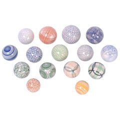 Set of Fifteen English Porcelain Carpet Balls