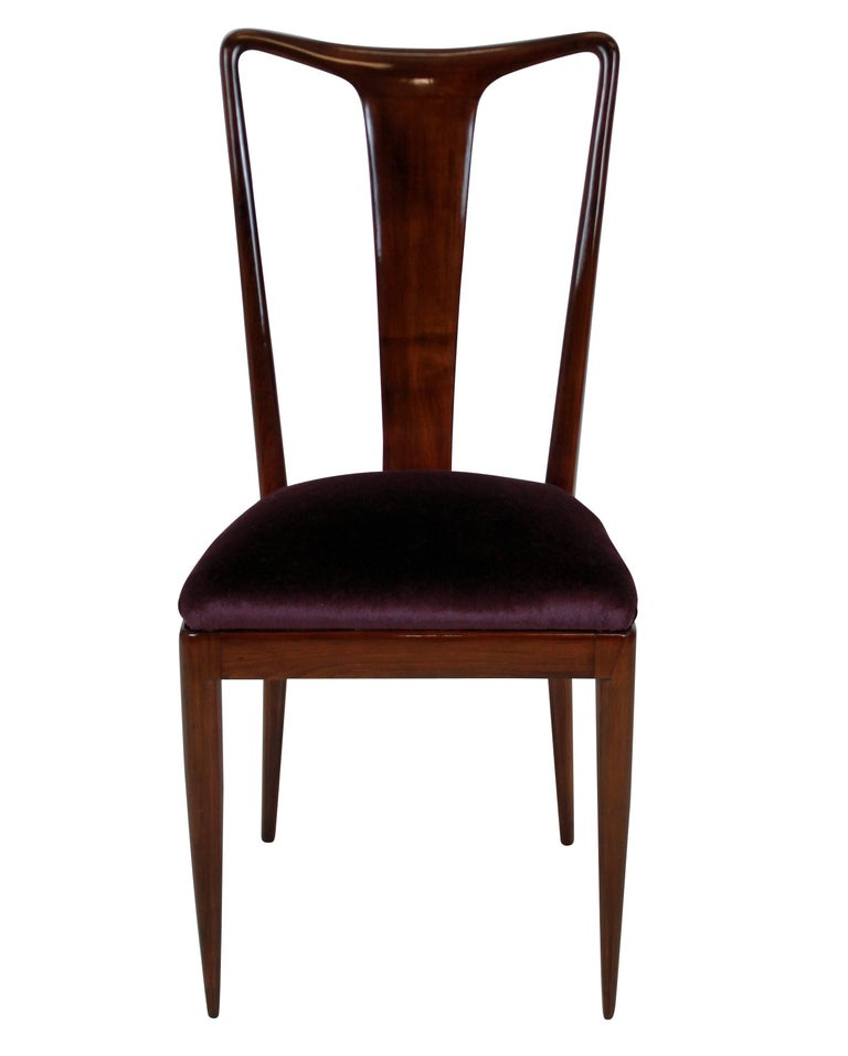 A set of six dining chairs of superb quality in the style of Ulrich. In beautifully sculpted and polished mahogany with Aubergine mohair velvet seats.