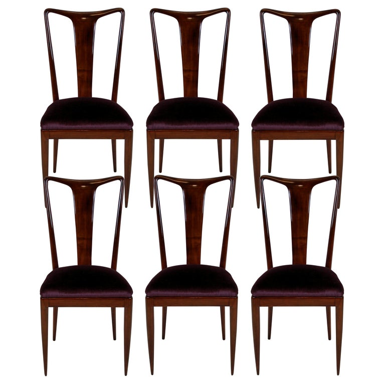 A set of six dining chairs of superb quality in the style of Ulrich. In beautifully sculpted and polished mahogany with aubergine mohair velvet seats.   Measure: 49 cm high (seats).