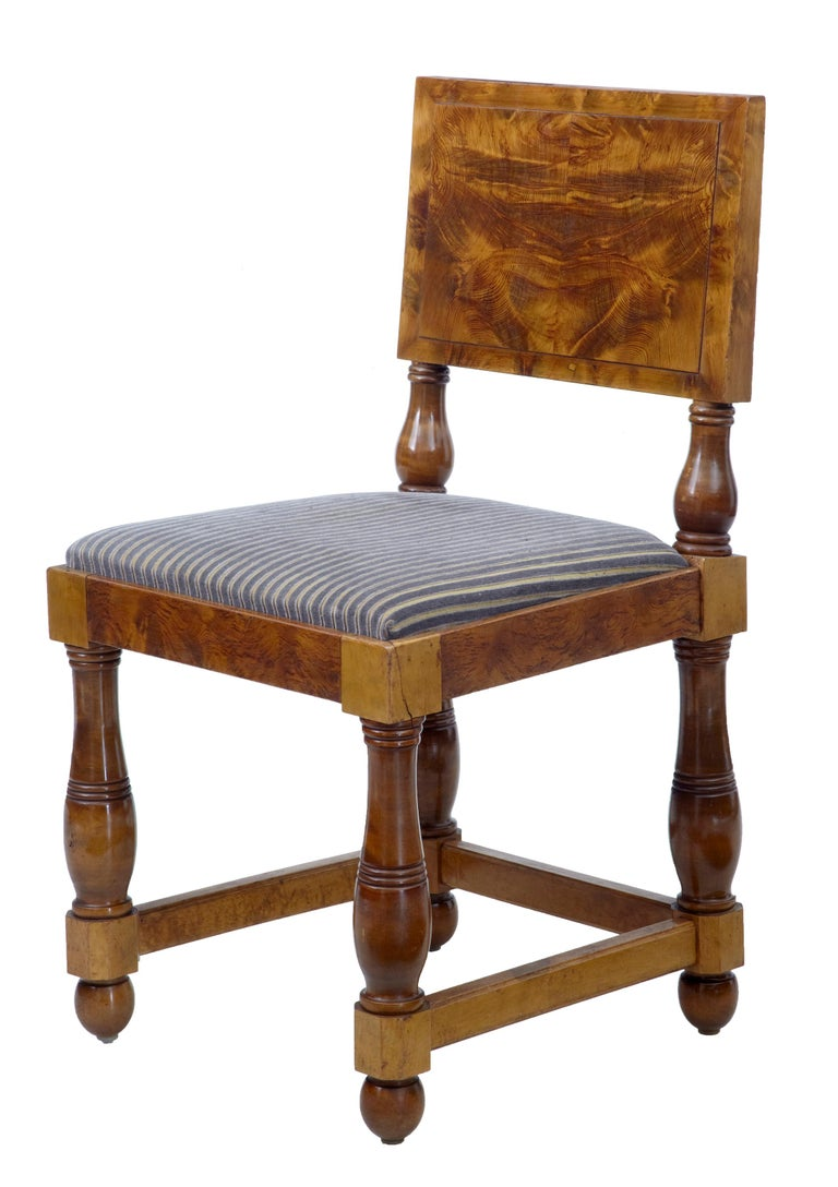 Unusual set of five pitch pine dining chairs, circa 1920. Rich golden color with striking grain. Standing on gun barrel turned legs. Upholstery clean and ready for everyday use.  Measures: Height: 34 1/3