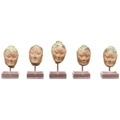 Set of Five Chinese Han Dynasty Terracotta Heads with Original Paint on Lucite