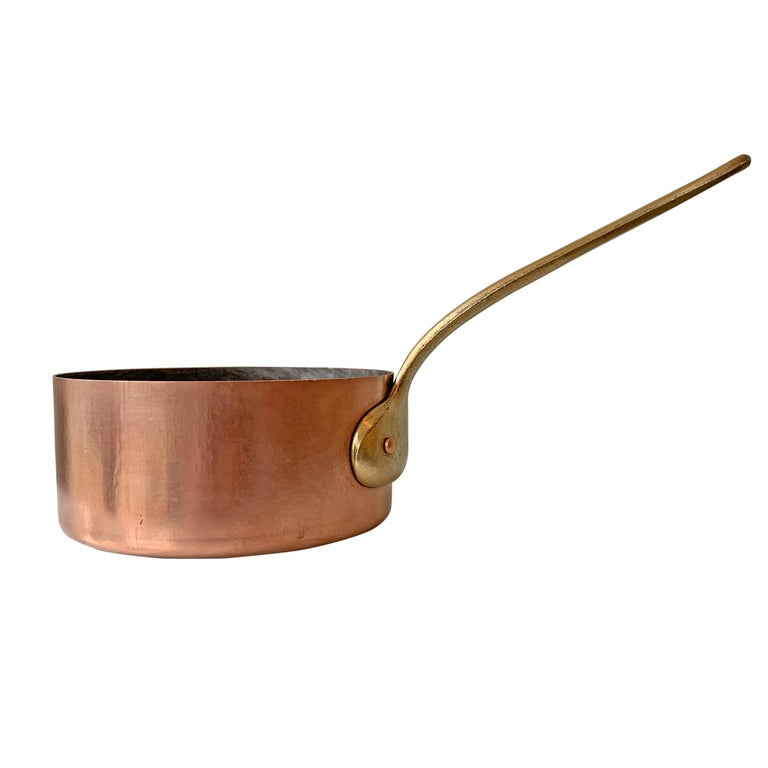 A sweet set of five early 20th century French miniature copper saucepans originally used to melt butter or keep sauces warm. Retaining their original tin linings, but we could have them retined for an additional charge.