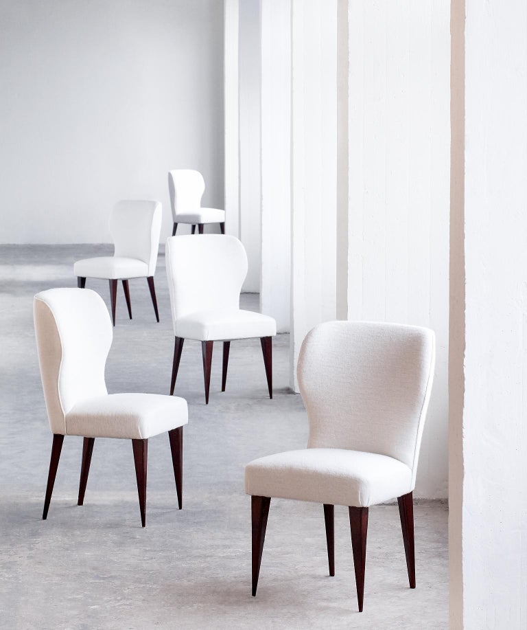 A rare set of five dining chairs designed by Gio Ponti in collaboration with Lio Carminati for the Casa E Giardino company in 1942. The particularly graphical lines of the tapered mahogany legs and the curved backrests give the chairs a modern and