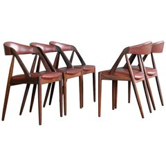 Set of Five Kai Kristiansen Rosewood and Red Leather Dining Chairs Model 31