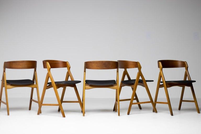 Set of 5 Kai Kristiansen dining chairs in teak with seats in Naugahyde.