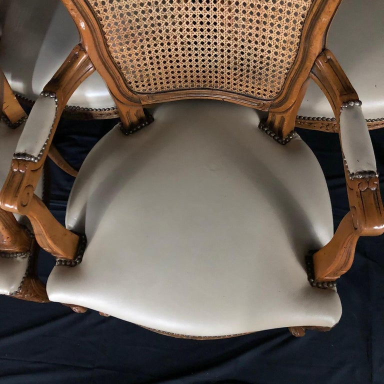 Cane Set of Five Louis XV French Walnut Chairs with Classic Brass Tacking For Sale