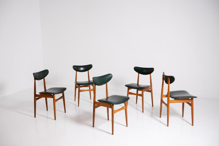 Nordic modernist set of five chairs from the 1950s. The chairs are in their original condition, also its upholstery is original of the time. 