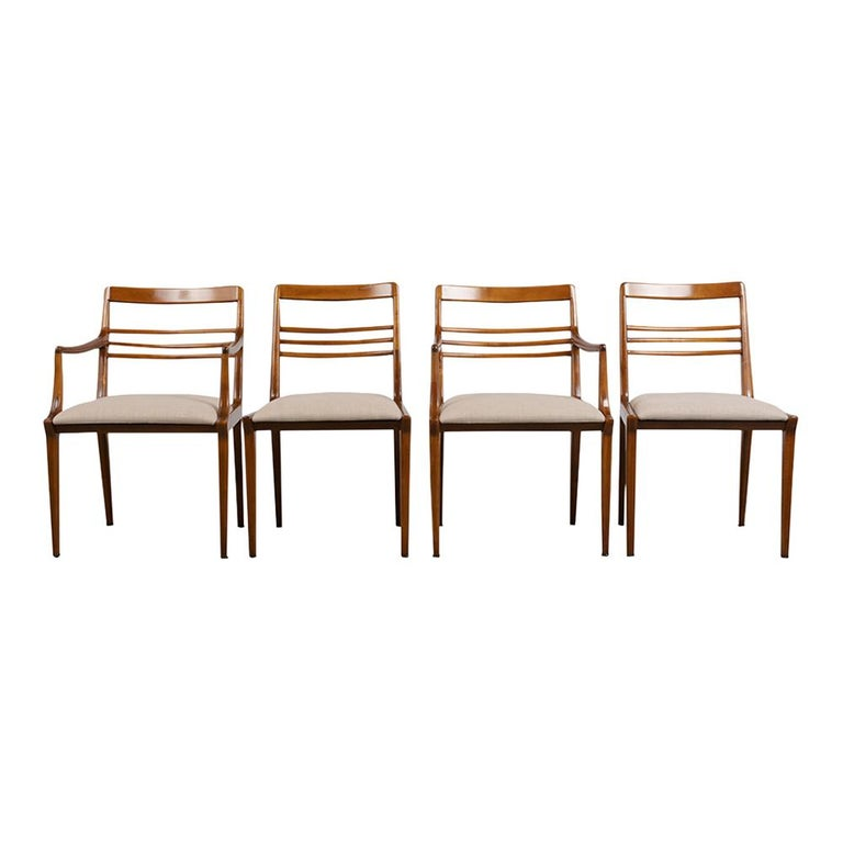 This Set of Five Mid-Century Modern Style Dining Chairs by Renzo Rutili for Johnson Furniture has been restored and is in great condition. This set of five features three side chairs & two armchairs made of solid maple wood finished in a natural