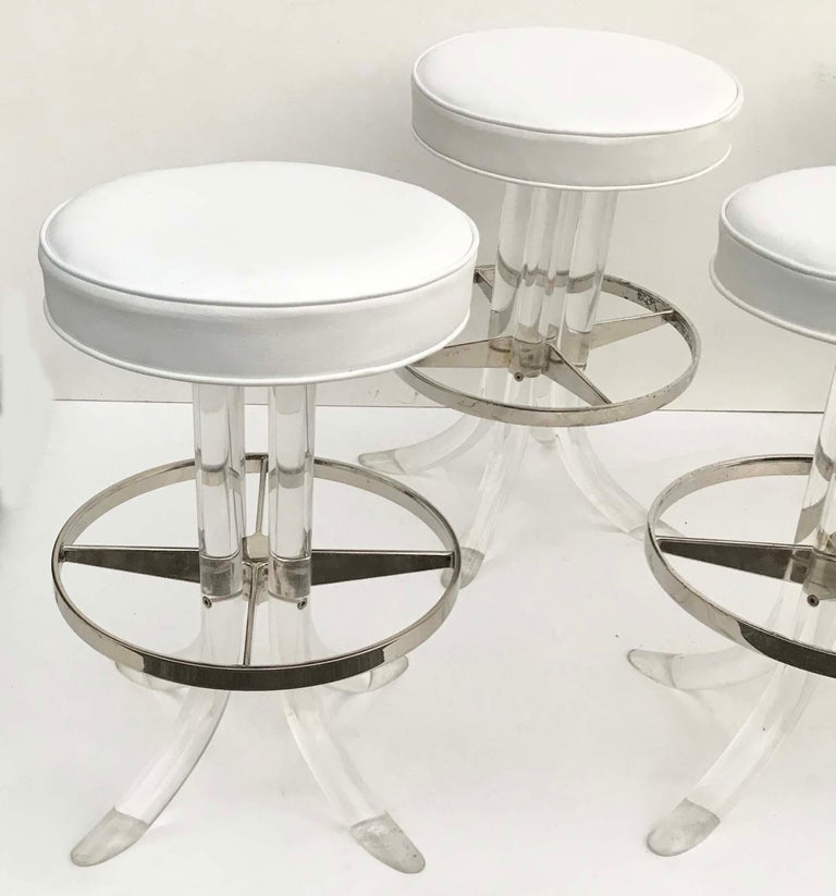 Superb set of 5  Swiveling Lucite barstools by Hill Manufacturing's  New seat white vinyl upholstery.   Base: 21