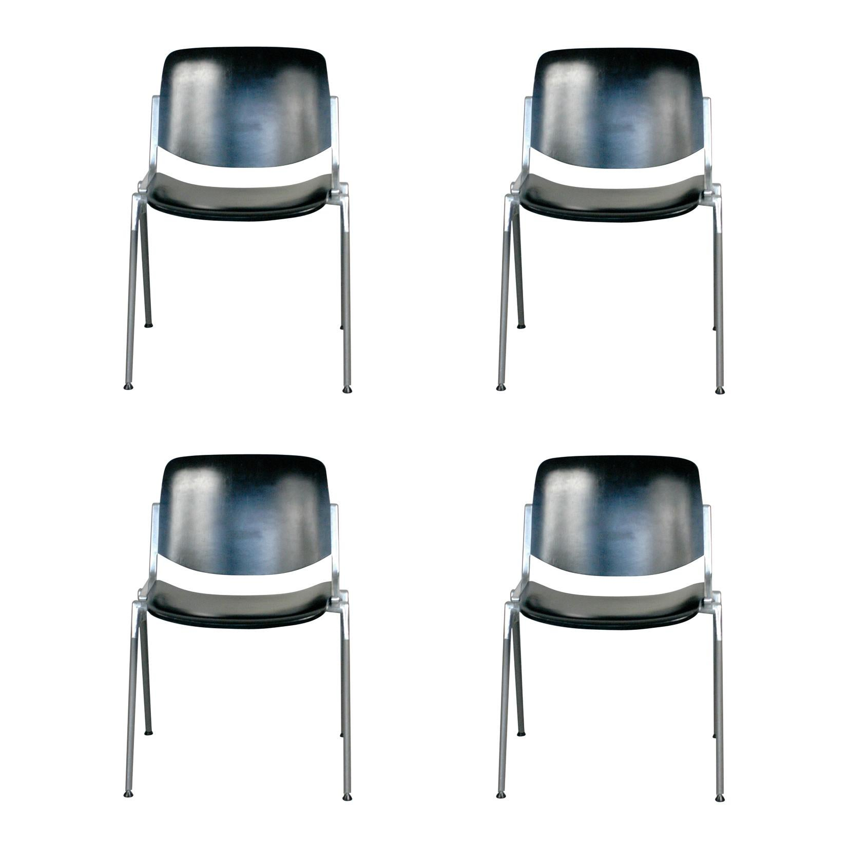 Set of Four Black Castelli Italy Dsc 106 Stacking Chairs by Giancarlo Piretti