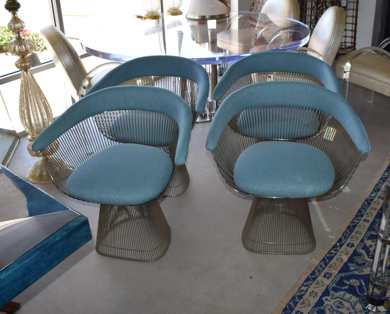 1970s, set of four armchairs cover with blue cotton fabric design by Warren Platner for Knollthe. The arm chair, which can be used as a dining chair or guess chair, is created by welding curved steel rods to circular and semi-circular frames,