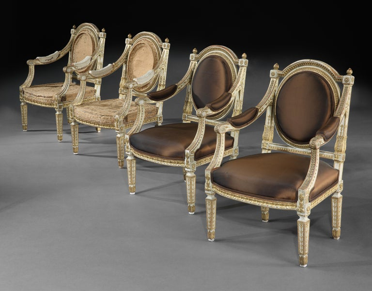 Extremely fine and decorative set of four 19th century Italian painted and parcel-gilt armchairs of neoclassical design, two upholstered and two for recovering.  Italian late 19th century - circa 1880-1900.  Oozing style these are very