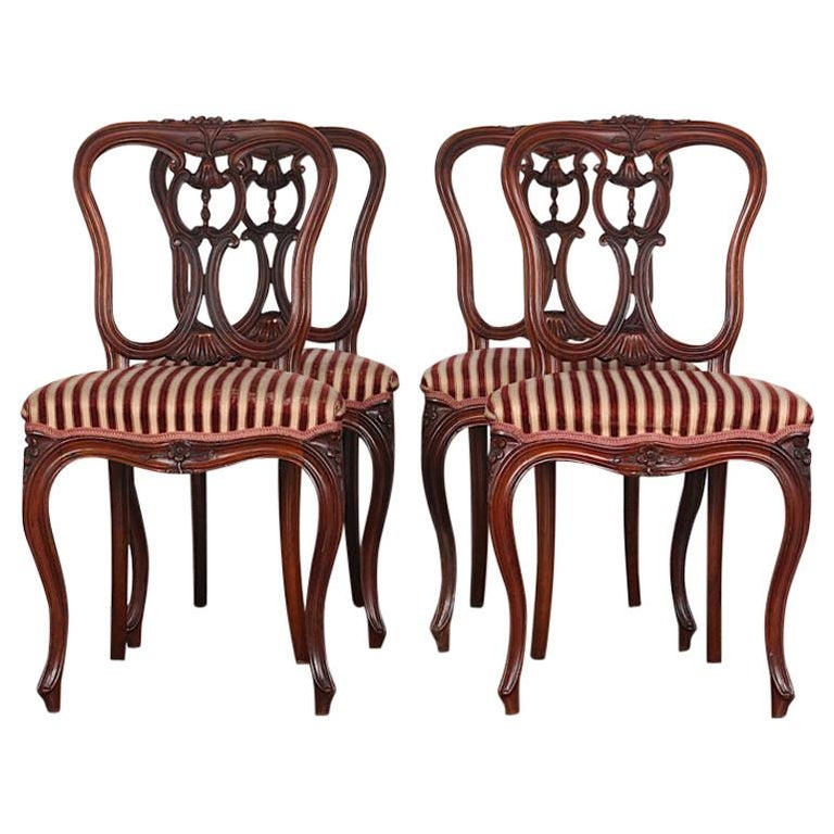 Set of Four 19th Century French Carved Mahogany Chairs For Sale