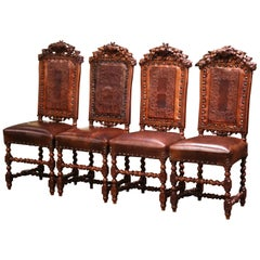 Set of Four 19th Century French Carved Oak and Leather Chairs with Hunt Motifs