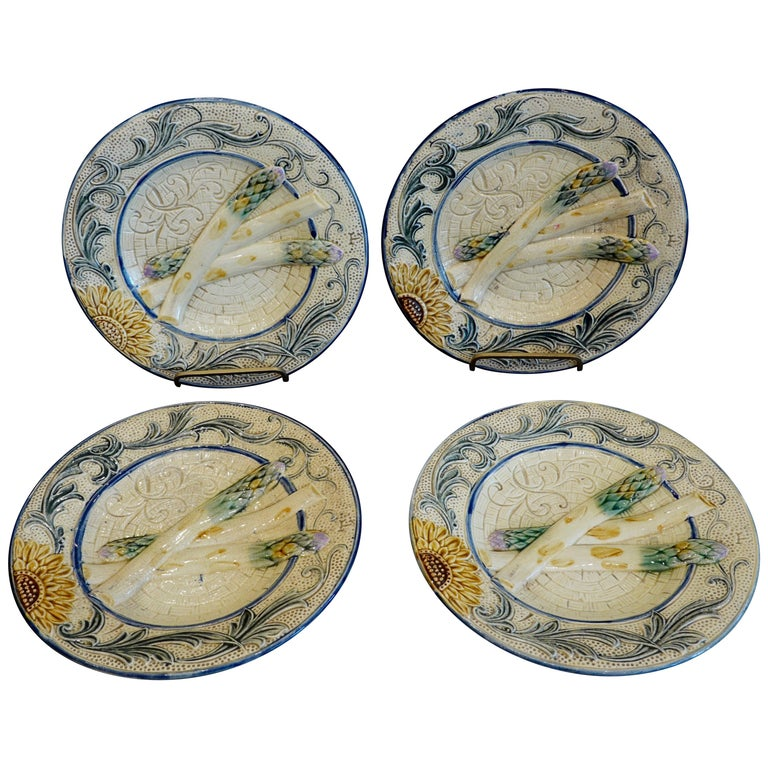 Set of Four 19th Century Majolica Asparagus Plates with Molded Sunflower For Sale