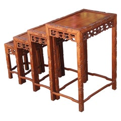 Set of Four 20th Century Carved Chinese Nesting Tables with Fancy Floral Pattern
