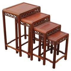 Set of Four 20th Century Modern Carved Chinese Nesting Tables