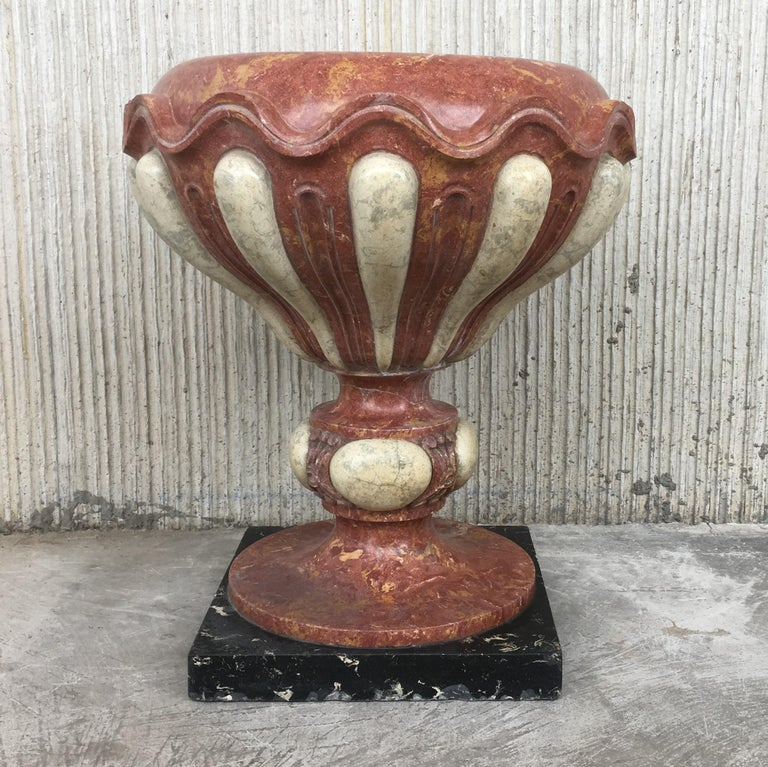 Set of four of aged pink marble hand carved planters with Serpentine white inlays and black marble base  Price per item.