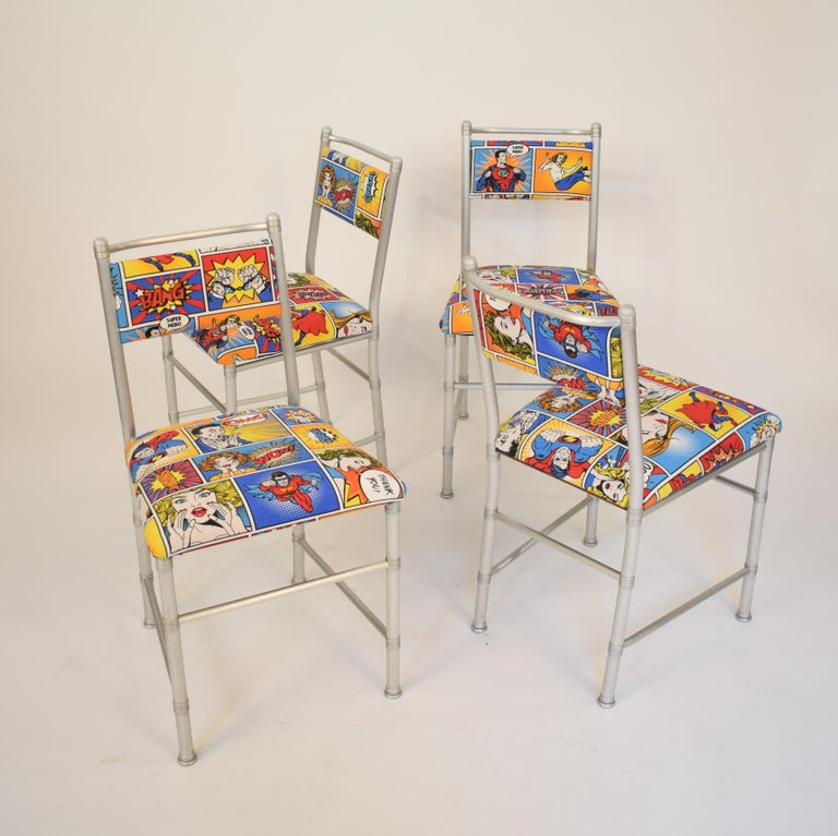 Those beautiful chairs are made out of aluminium and the seats are upholstered in a Pop-Art Comic Fabric which are great fun. This authorized reproduction of the Warren McArthur chairs was produced by ClassiCon in the 1970s in Italy. It was a