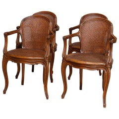 Set of Four Antique French Louis XVI Carved Walnut and Caned Armchairs