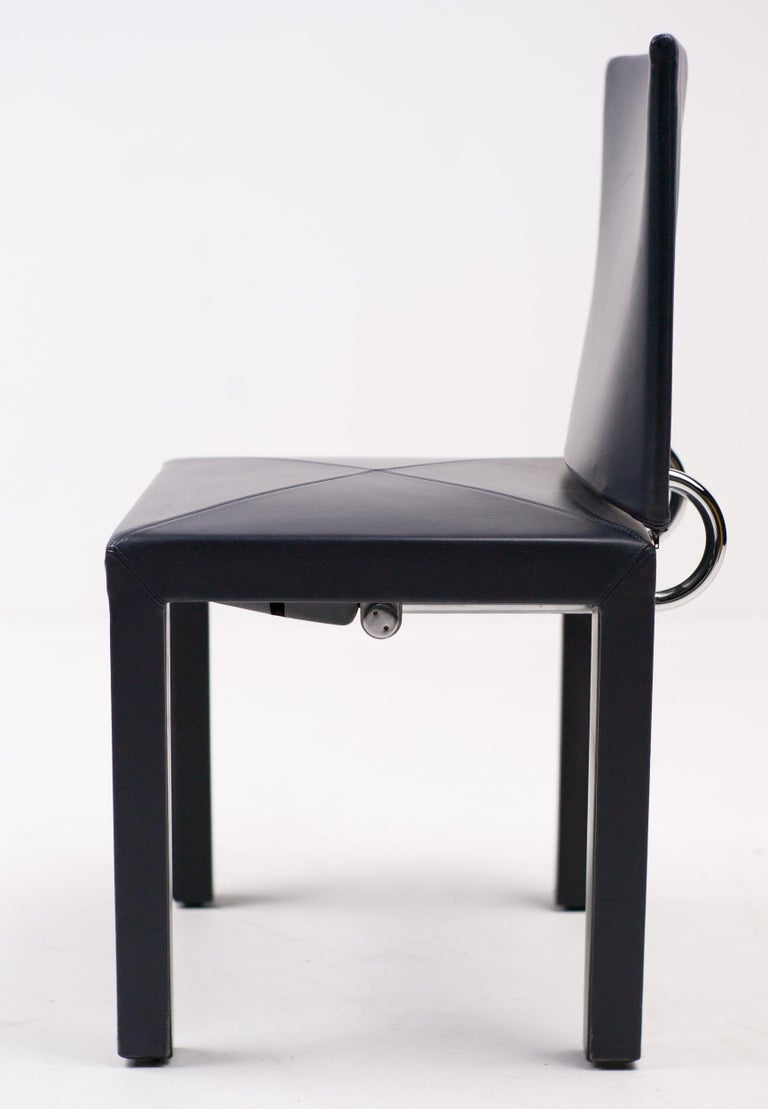 These Arcadia dining chairs were designed by Paolo Piva and manufactured by B&B Italia. The seat backs are joined to the base with black enameled steel tubing, which allows for some give and provides much comfort. The chairs are upholstered
