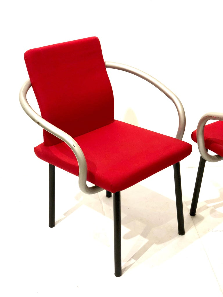 Nice set of four Mandarin chairs designed by Sottsass for Knoll, in red fabric on foam black enameled tubular legs and silver pipping arms, simple and elegant by this master architect.