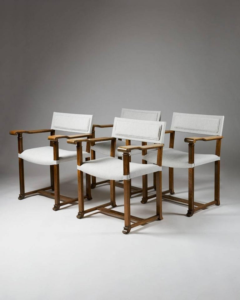 Set of four armchairs designed by Carl Bergsten,  Sweden, 1920s.  Oak and linen.