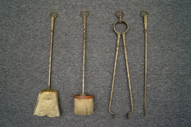 A set of four Arts & Crafts hand forged fire utensils on a hand forged iron stand.