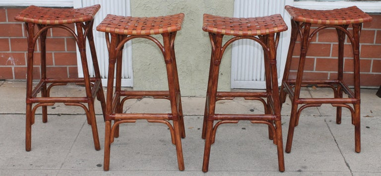 These Mid-Century Modern bamboo bar stools are in fine condition and have handwoven leather seats. They are counter or bar height. Super comfortable.