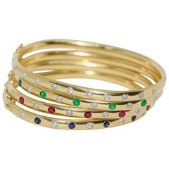 Set of Four Bangles, 18 Karat Gold Set with Diamonds, Sapphires and Emeralds