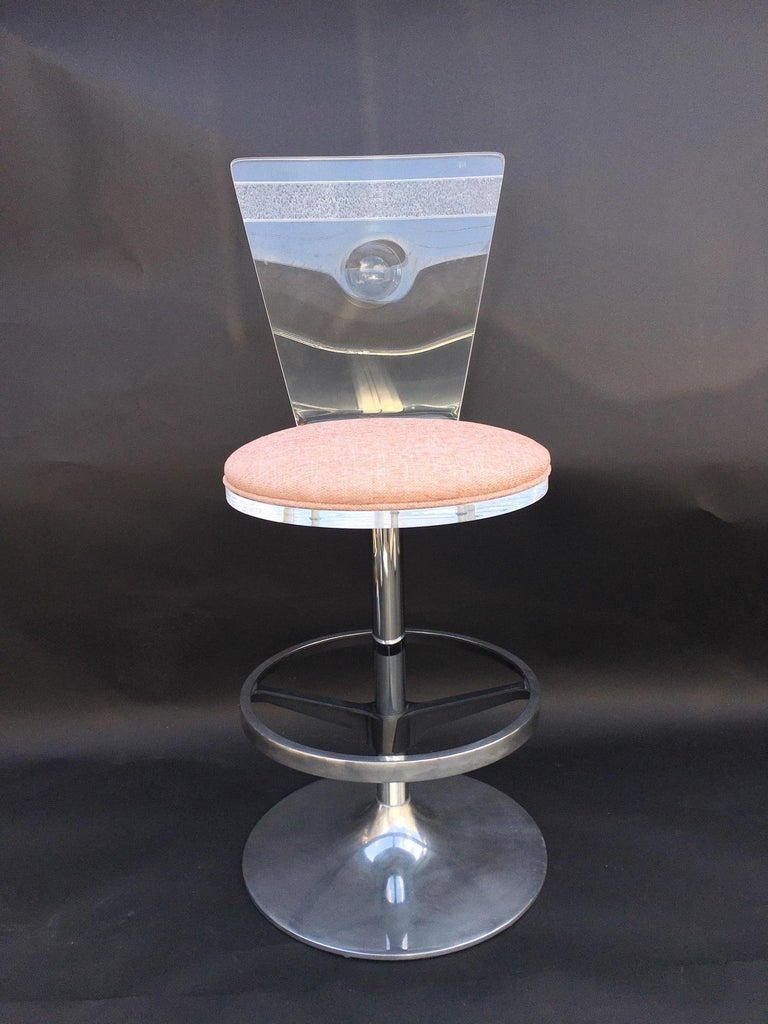 Set of four metal and acrylic bar stools, U.S.A, 1980s.