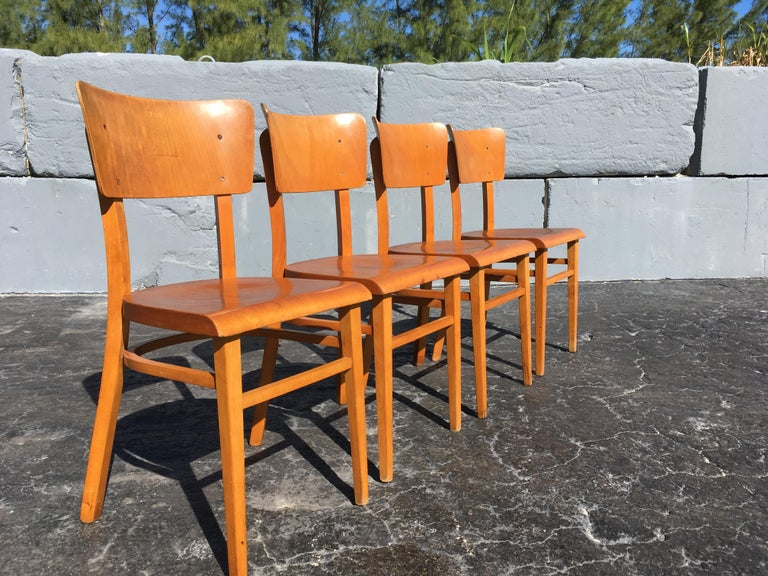 4 beautiful European dining chairs with bentwood seats and backs. Great for the Kitchen.
