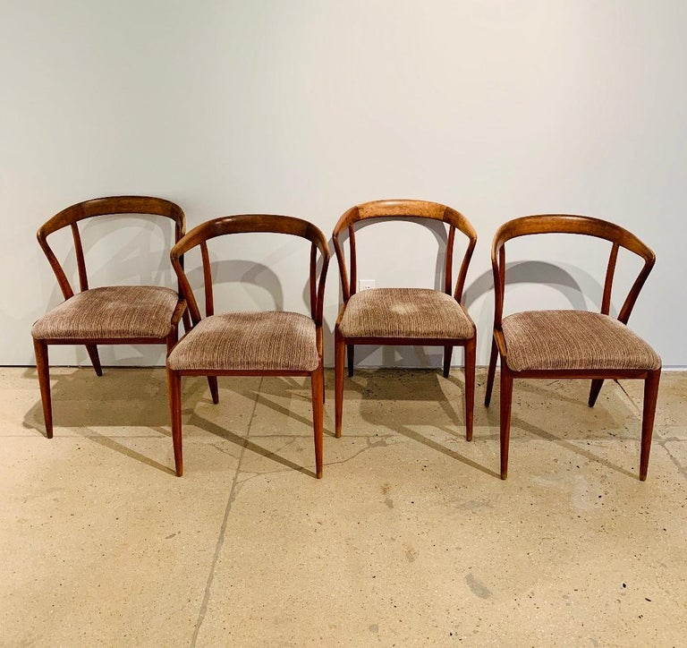 A set of sculptural light/medium walnut chairs by Bertha Schaefer for Singer and Son. Reupholstered in a golden cream blended silk. Original Tag. Chairs were made in Italy for Singer and son. Listed price is for 4. 8 chairs is $8800. An Italian