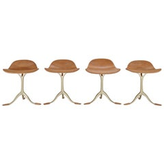 Set of Four Bespoke Sand Cast Brass Stools in Marron Glacé Leather